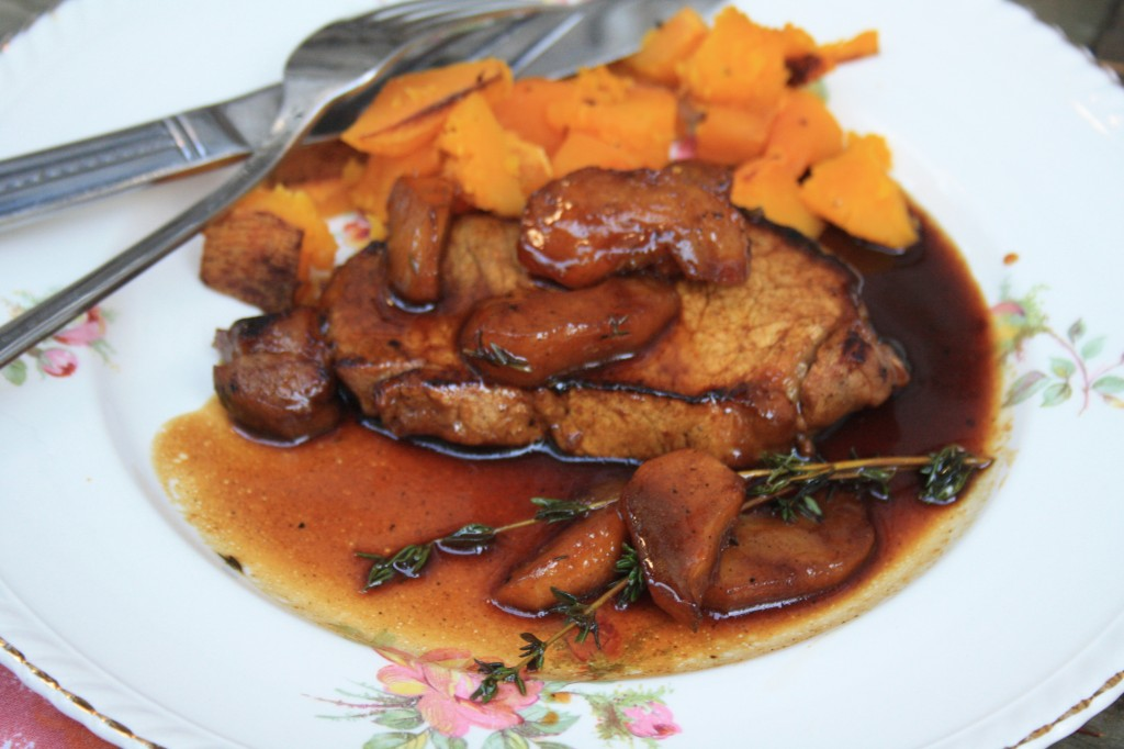Pork chops with sauteed apples and molasses cider glaze