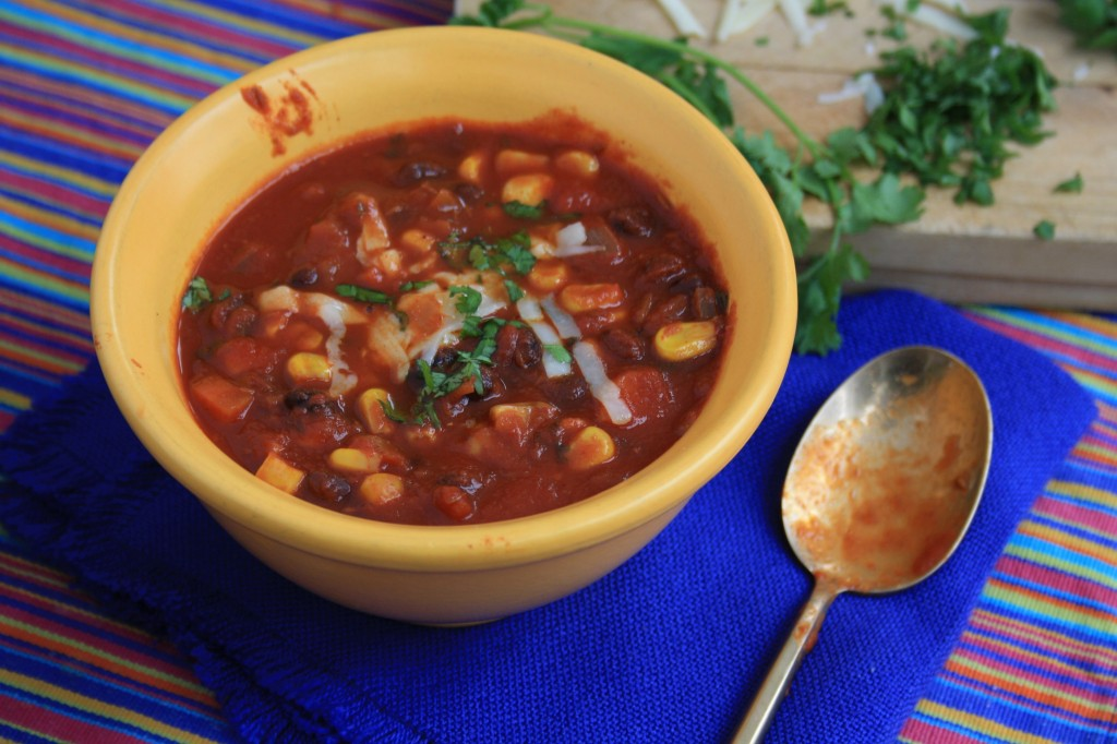 This hearty vegetarian black bean chili combines sweet with heat, and is chock full of corn and carrots too.