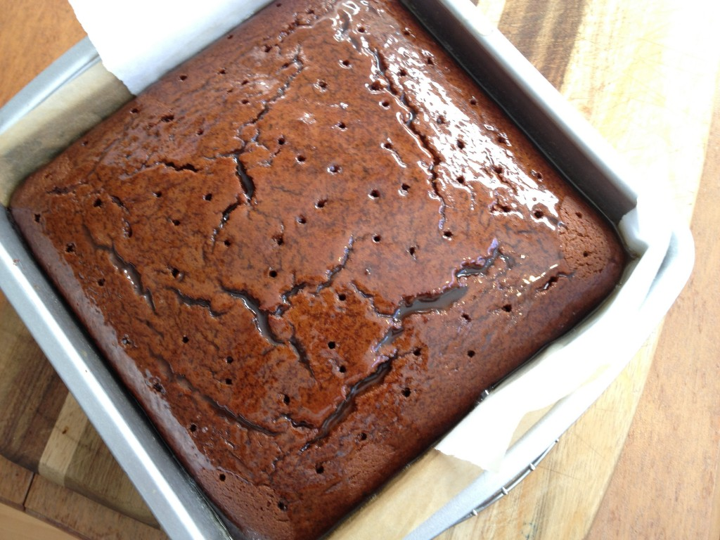 Buttery brown sugar sauce over ginger cake