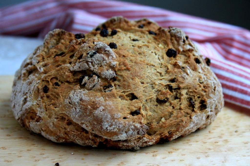 Irish soda bread with molasses is quick to mix up and delicious. You can have a loaf on the table in under ab hour. And what a lovely loaf it is, round and crackled on top.