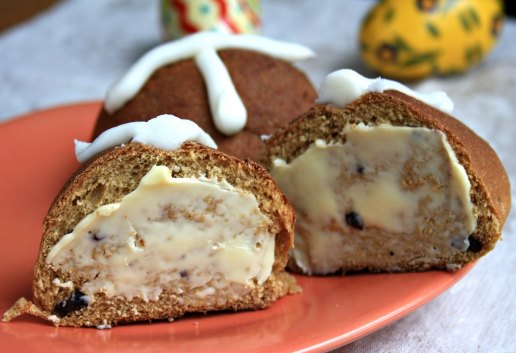Simple and festive hot cross buns lightly spiced and studded with currants and raisins.