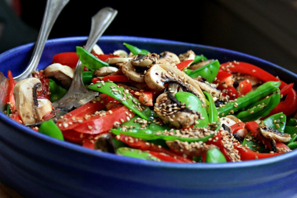 Snowpea and red pepper salad with walnut dressing pretty on a buffet table and so delicious